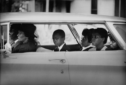 The Chaney family as they depart for the burial of James Chaney, Meridian, Mississippi, August 7, 1964. (© Bill Eppridge)